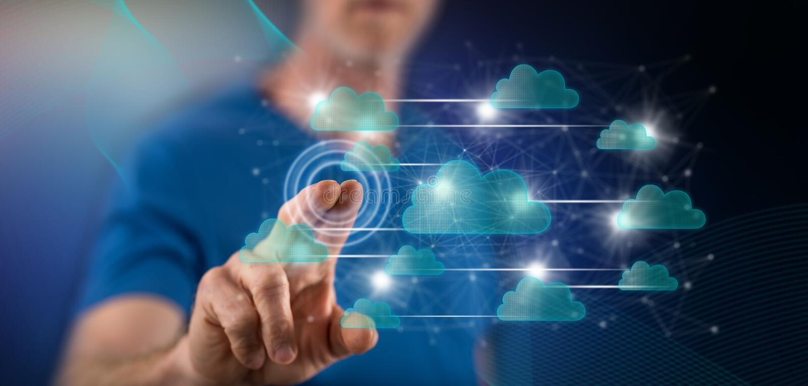 Man touching a cloud networking concept. On a touch screen with his finger royalty free stock photos