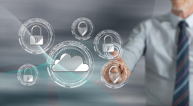 Man touching a cloud security concept. On a touch screen with his finger stock photography