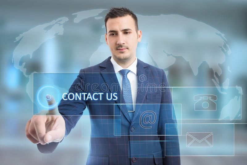 Man touching contact us on transparent display stock photography