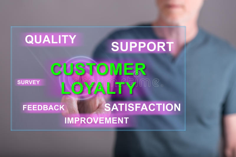 Man touching a customer loyalty concept on a touch screen royalty free stock image