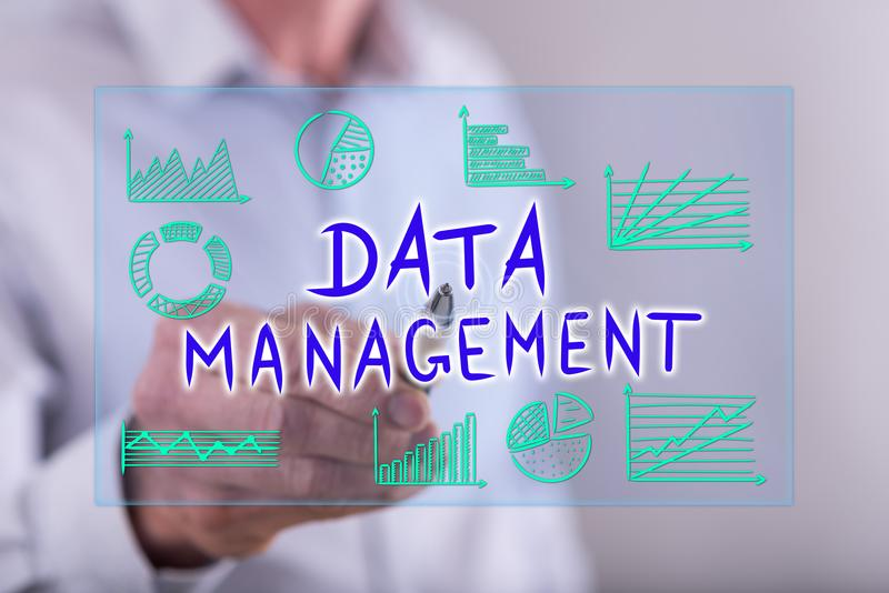 Man touching a data management concept on a touch screen stock images
