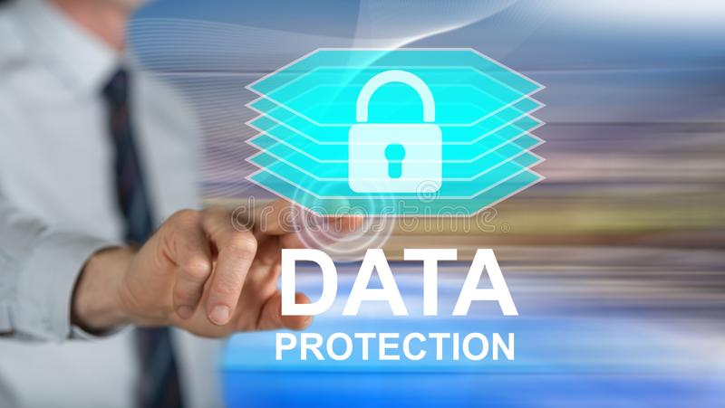 Man touching a data protection concept stock photo