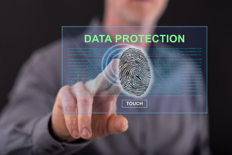 Man touching a data protection concept on a touch screen royalty free stock photos