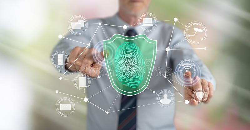 Man touching a data security concept. On a touch screen with his fingers royalty free stock photography