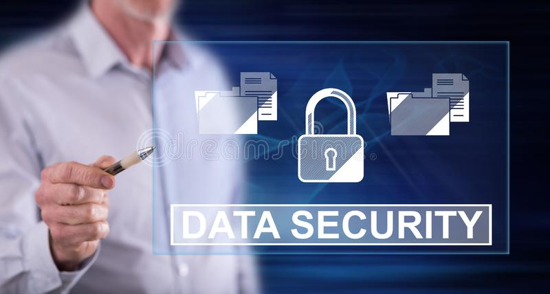 Man touching a data security concept. On a touch screen with a pen stock photos