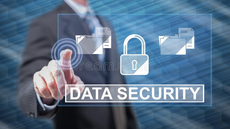 Man touching a data security concept. On a touch screen with his fingers royalty free stock image