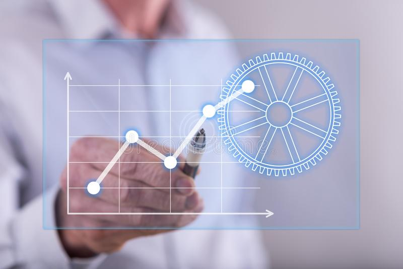 Man touching a digital business analysis concept on a touch screen royalty free stock images