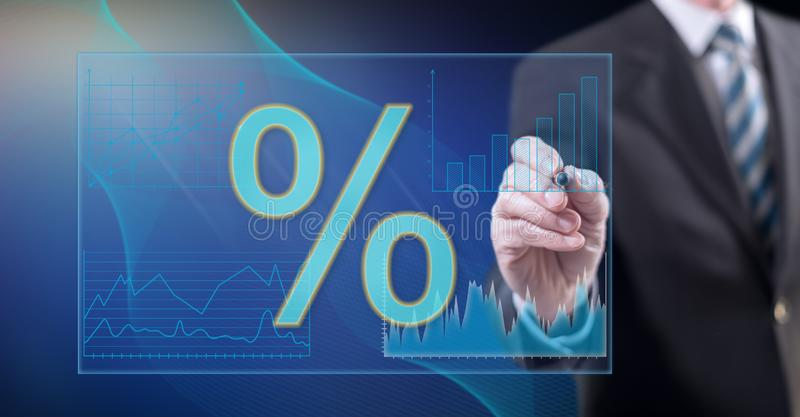 Man touching digital interest rates data stock illustration