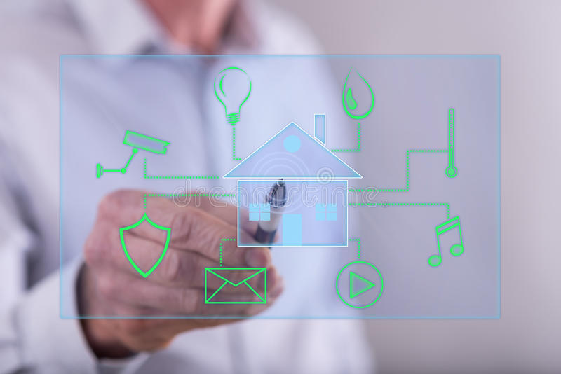 Man touching a digital smart home automation concept on a touch screen stock photo