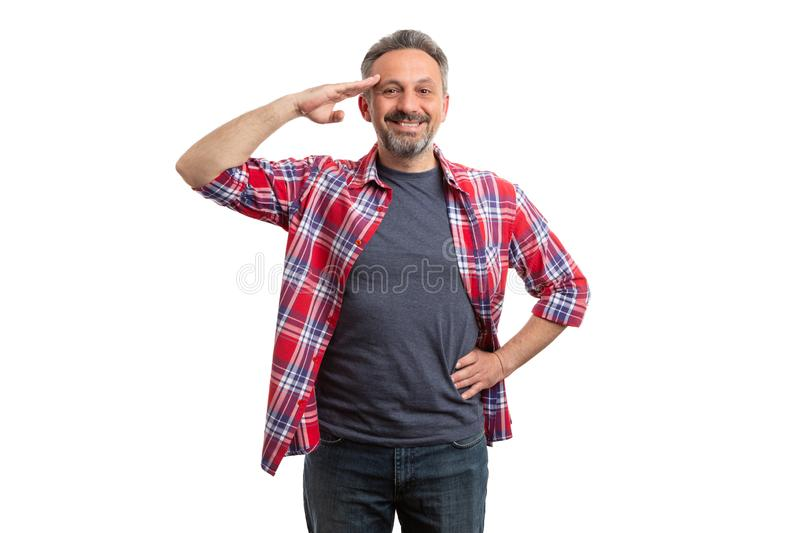 Man touching forehead with hand as military salute stock images