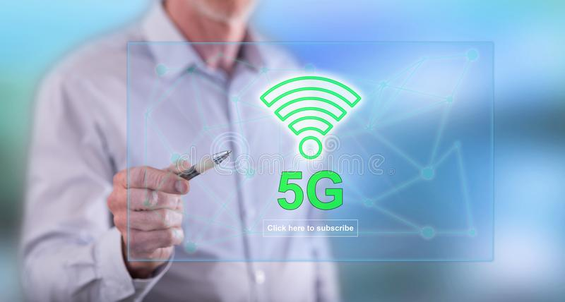 Man touching a 5g concept on a touch screen. With a pen stock image