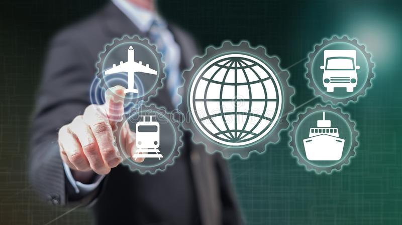 Man touching a global transportation concept. On a touch screen with his fingers royalty free stock image