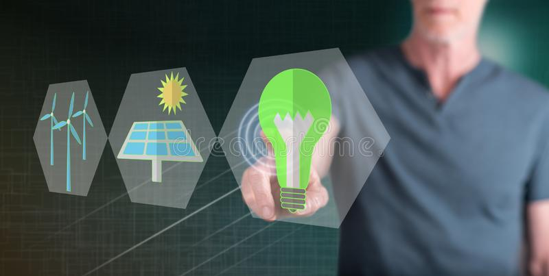 Man touching a green energy concept stock images