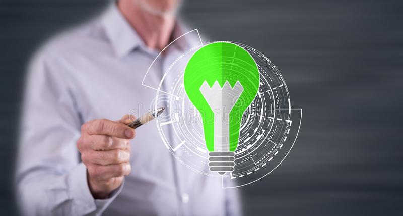 Man touching a green energy concept royalty free stock image