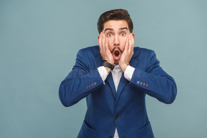 Man touching hands cheek and shouting royalty free stock image