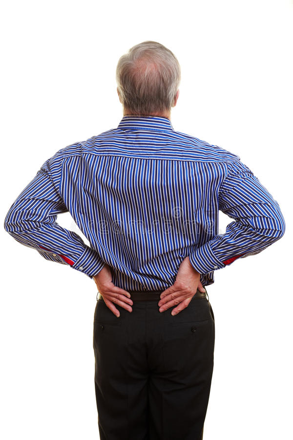 Man touching his back. Elderly man holding hands to his aching back royalty free stock photos
