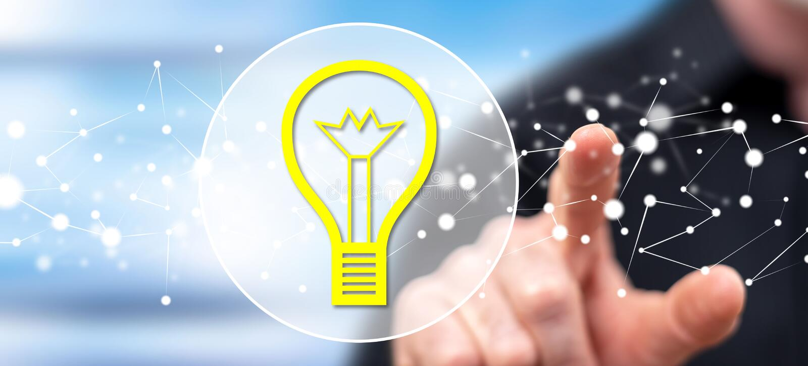Man touching an idea concept. On a touch screen with his finger stock image