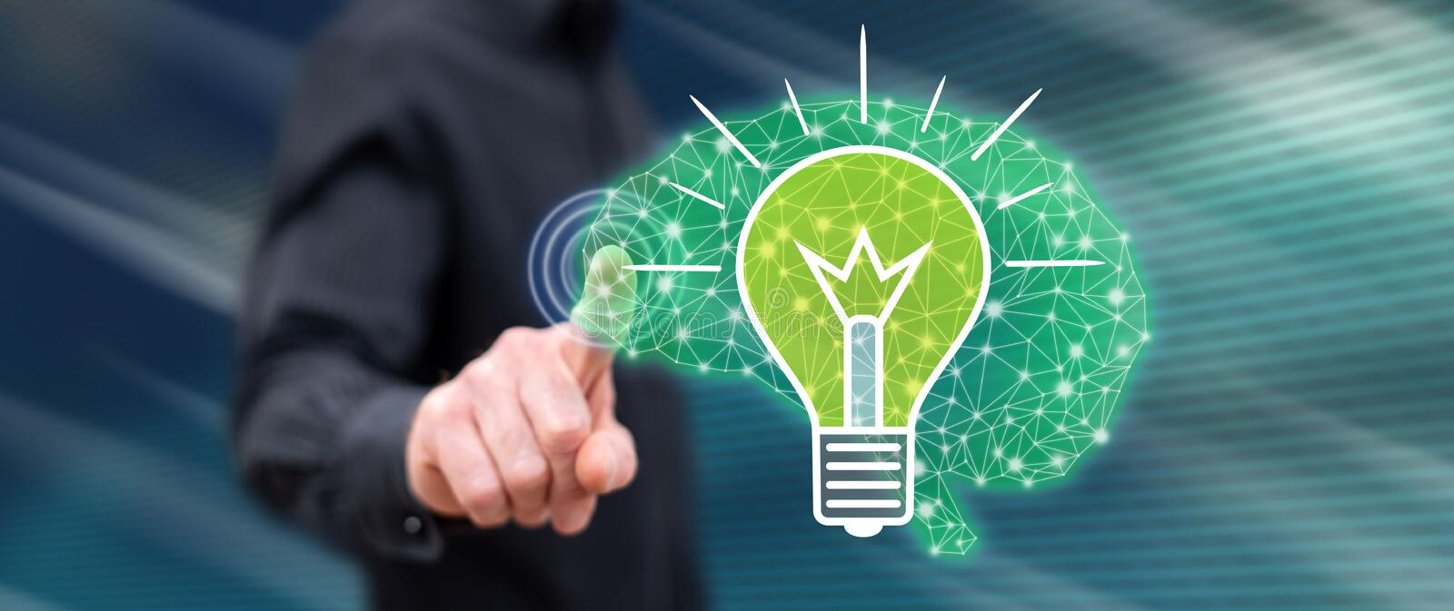Man touching an idea concept. On a touch screen with his finger royalty free stock image