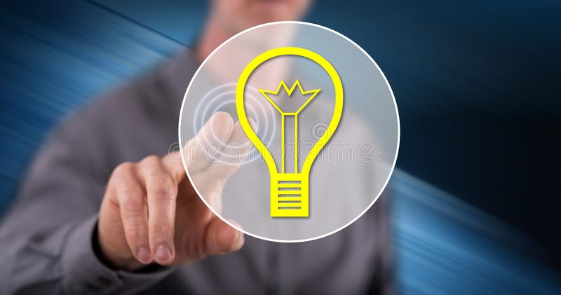 Man touching an idea concept. On a touch screen with his finger stock images