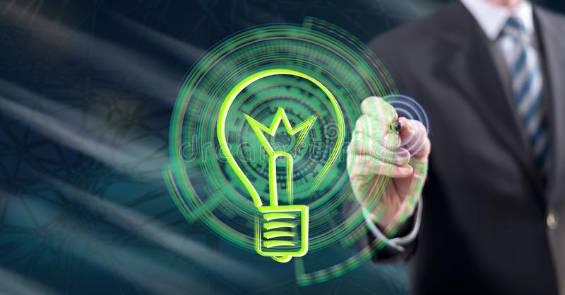 Man touching an idea concept. On a touch screen with a stylus pen royalty free stock images