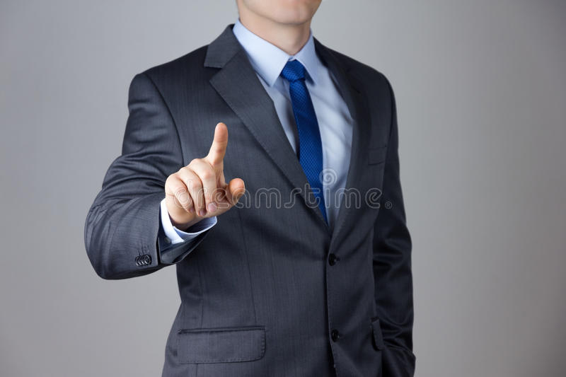 Man touching an imaginary screen royalty free stock images