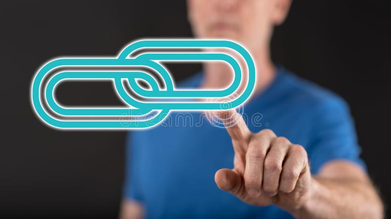 Man touching a link concept on a touch screen. With his finger royalty free stock photo
