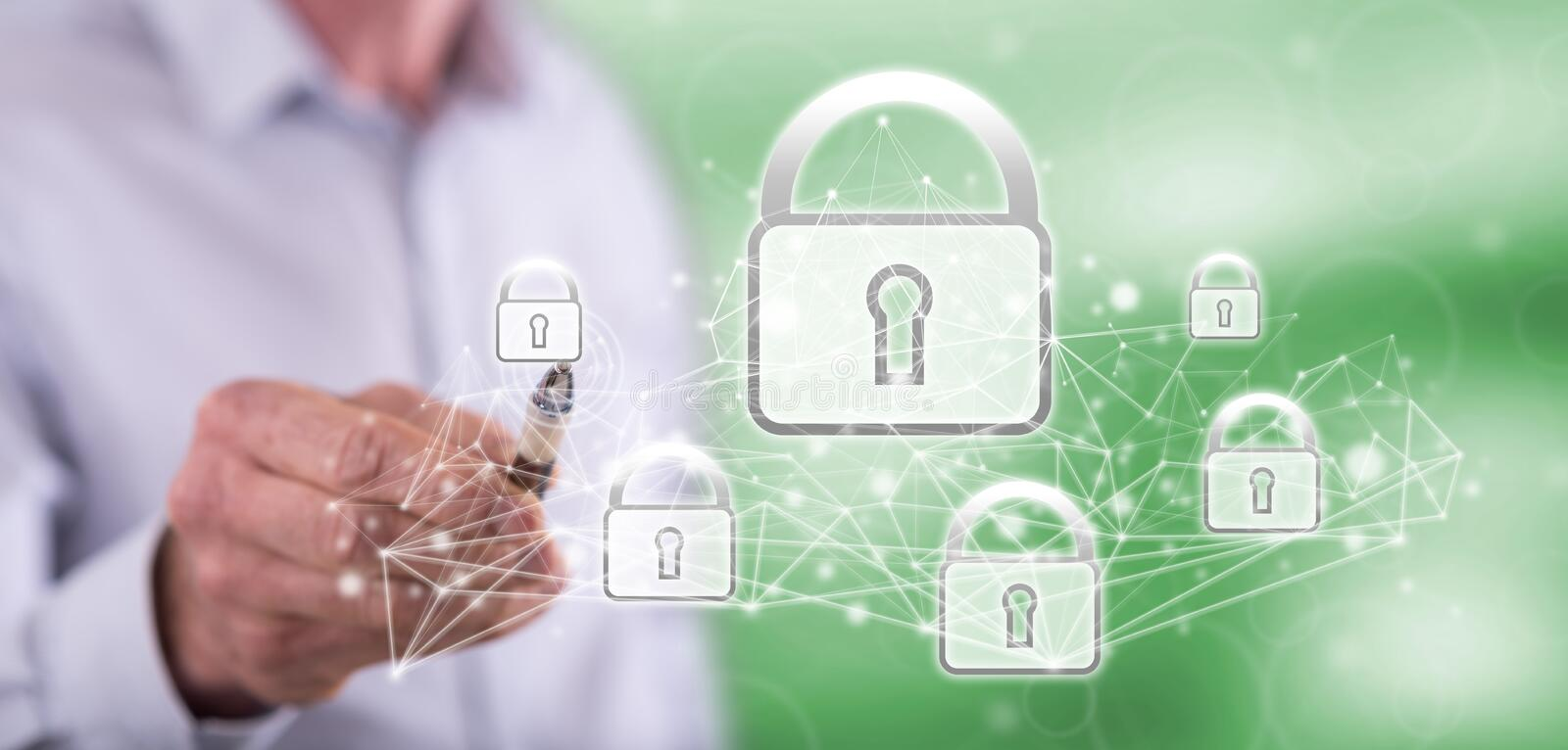 Man touching a network security concept stock photo