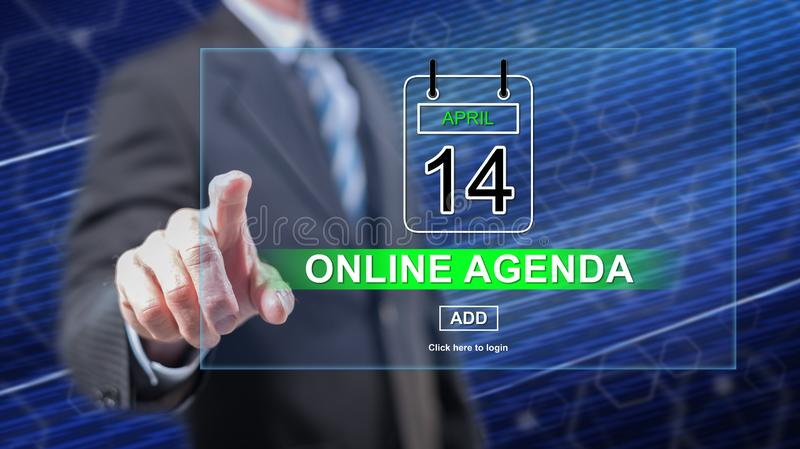 Man touching an online agenda concept. On a touch screen with his fingers stock photography