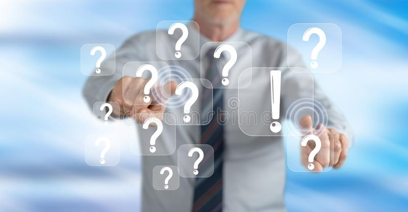 Man touching a q&a concept stock photography