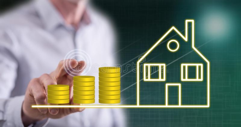 Man touching a real estate investment concept stock photos
