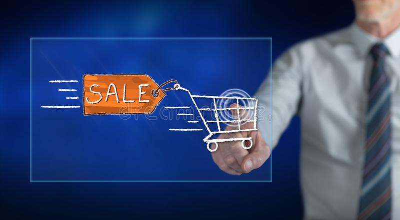 Man touching a sale concept. On a touch screen with his finger royalty free stock photos