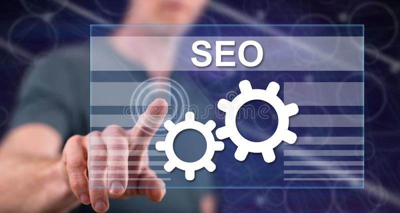 Man touching a seo concept stock photography