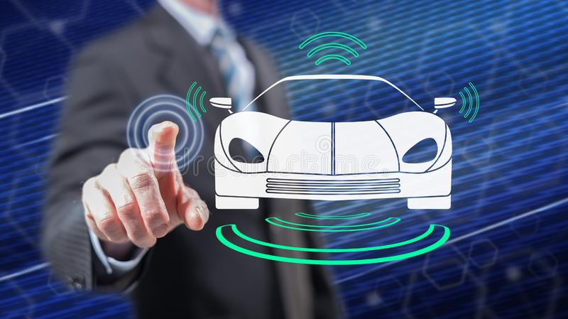 Man touching a smart car concept. On a touch screen with his fingers stock photography