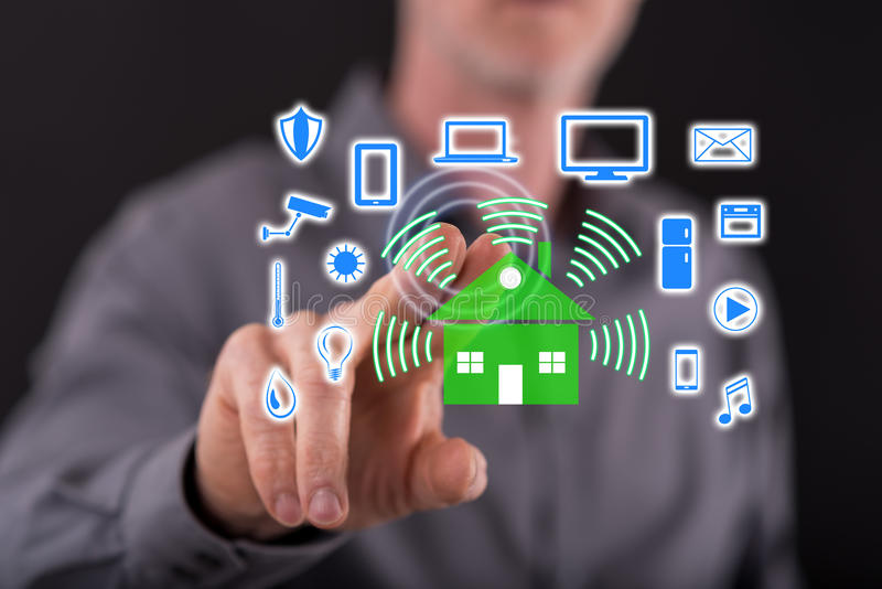 Man touching a smart home concept on a touch screen stock photo