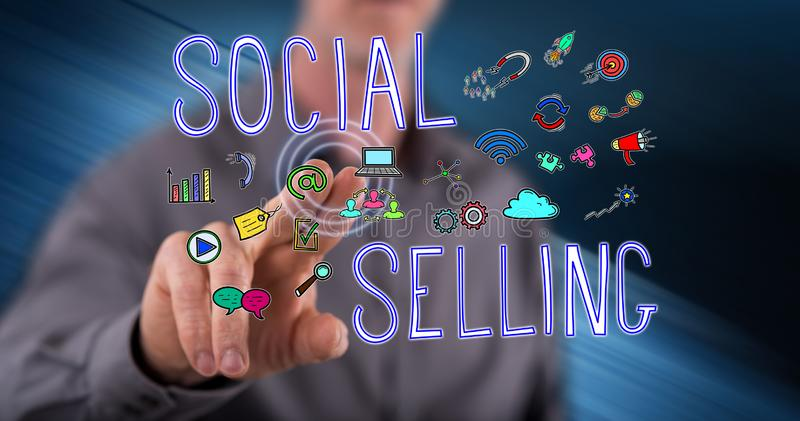Man touching a social selling concept. On a touch screen with his finger stock photo