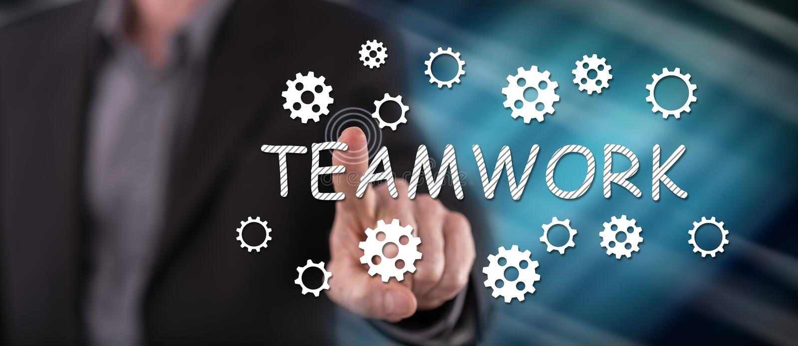 Man touching a teamwork concept. On a touch screen with his finger royalty free stock photos