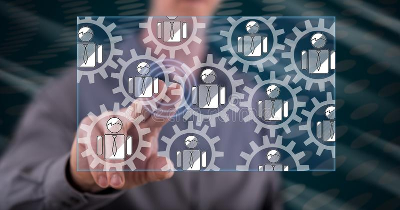 Man touching a teamwork concept. On a touch screen with his finger royalty free stock image