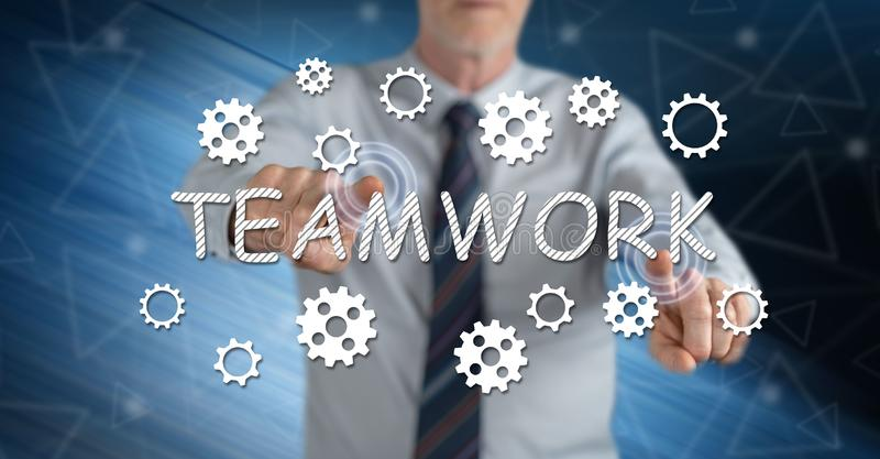 Man touching a teamwork concept stock photography