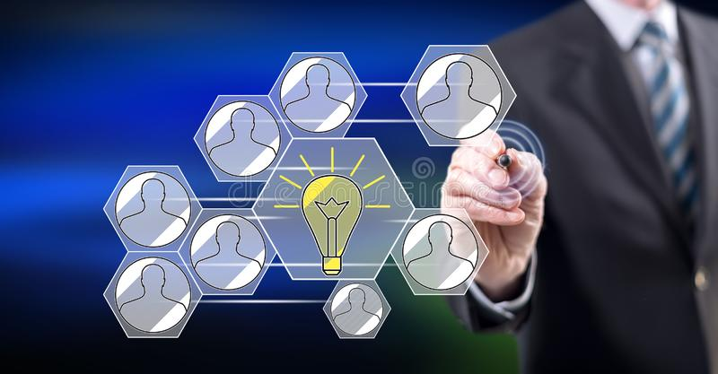 Man touching a teamwork idea concept. On a touch screen with a stylus pen royalty free stock photos