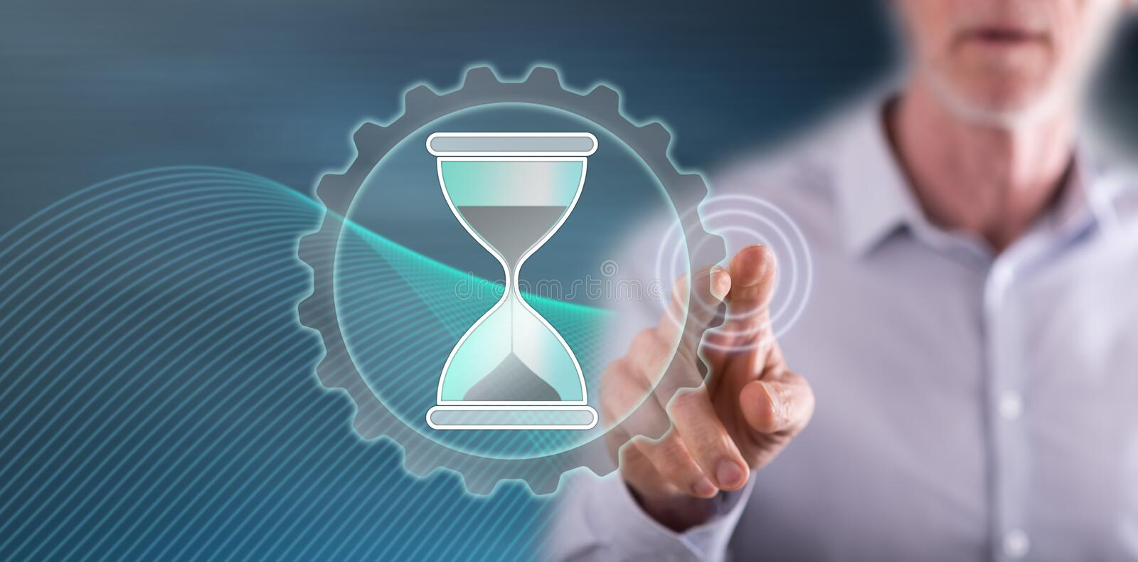 Man touching a time management concept stock photo