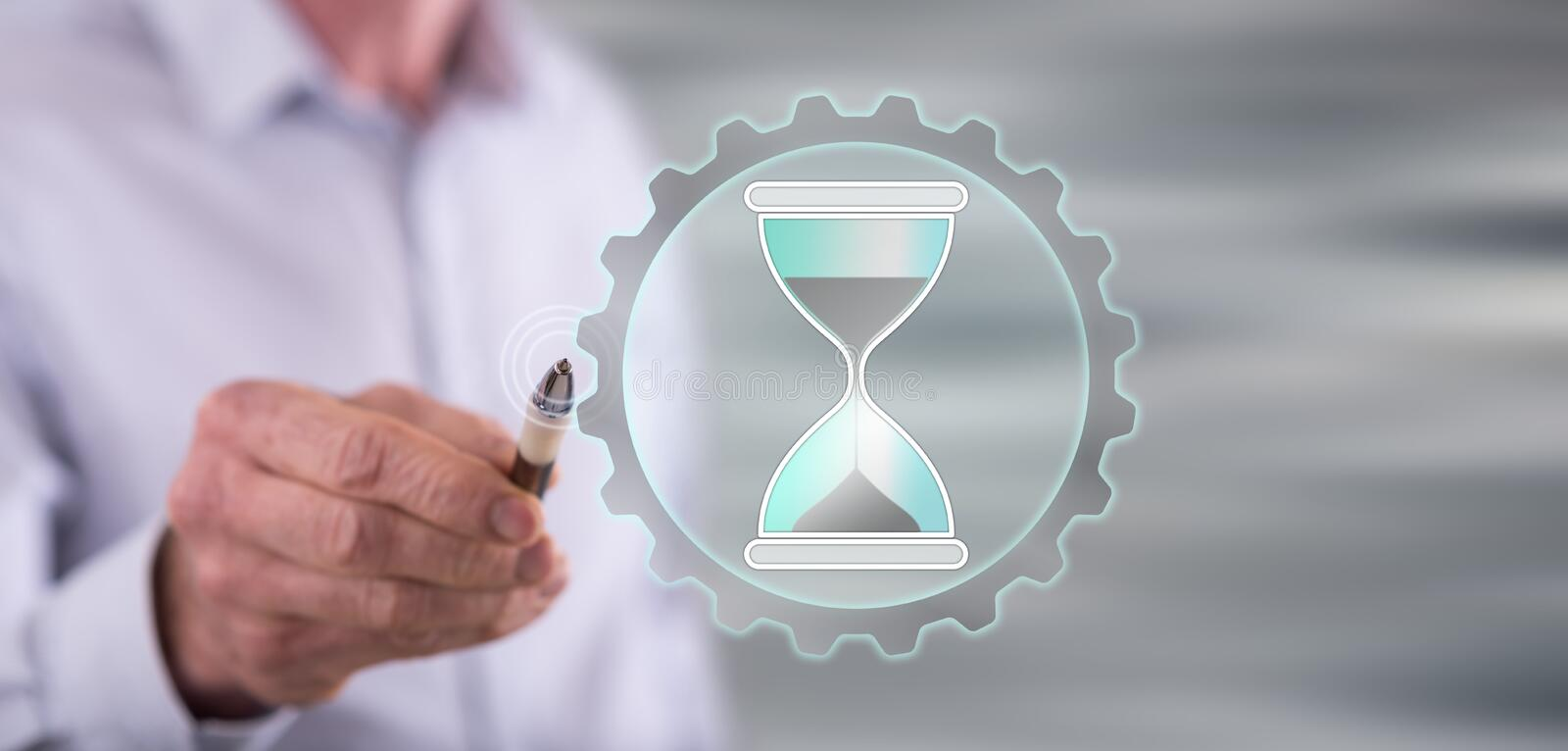 Man touching a time management concept stock images