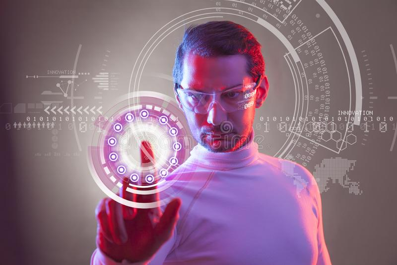 Man touching the virtual future interface stock photography