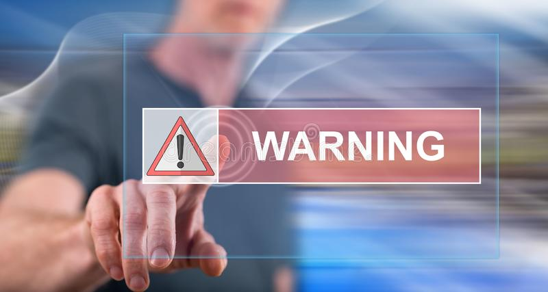 Man touching a warning concept. On a touch screen with his finger royalty free stock photo