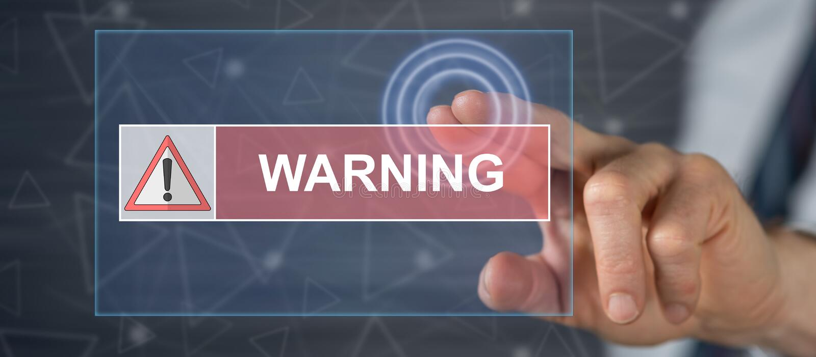 Man touching a warning concept. Man ing a warning concept on a  screen with his finger stock photo