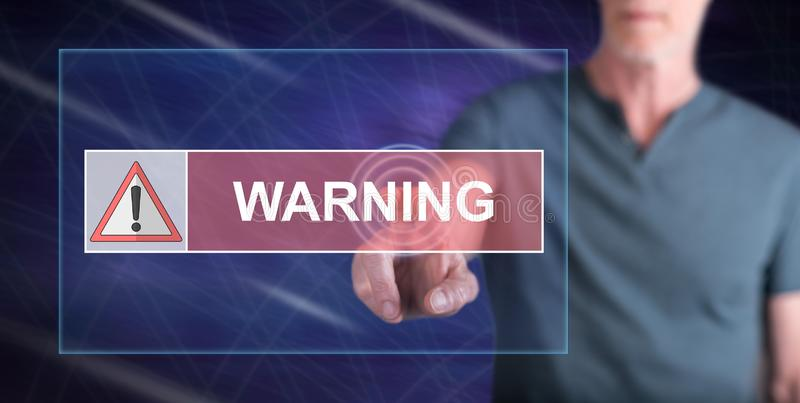 Man touching a warning concept. On a touch screen with his finger stock photo