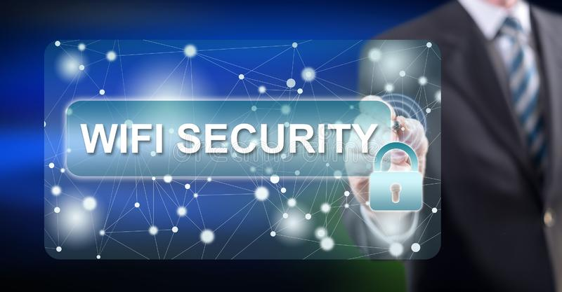 Man touching a wifi security concept. On a touch screen with a stylus pen royalty free stock photo