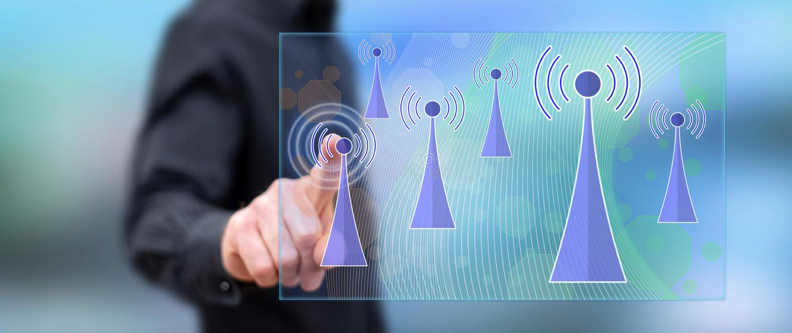 Man touching a wifi signal concept royalty free stock images