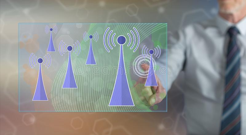 Man touching a wifi signal concept royalty free stock photo
