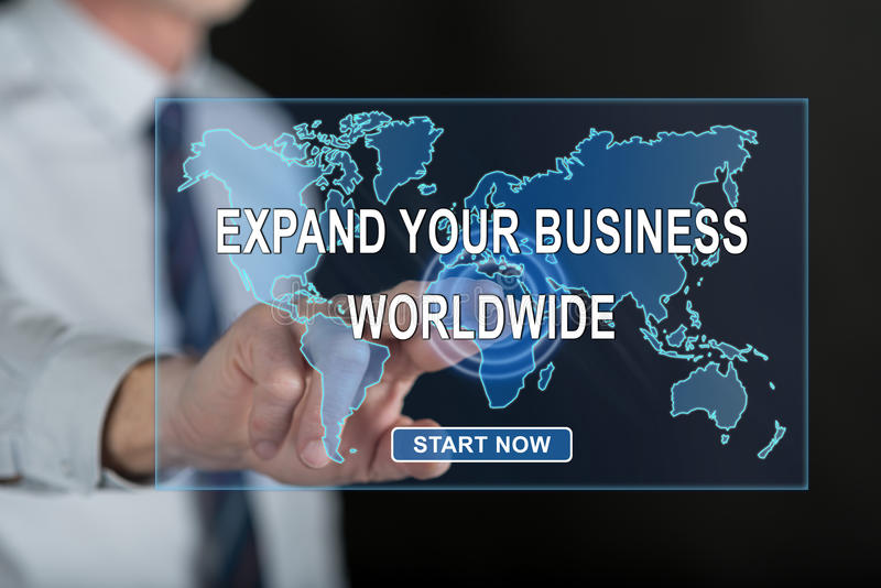 Man touching a worldwide business development concept on a touch screen royalty free stock image