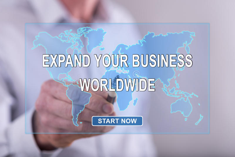 Man touching a worldwide business development concept on a touch screen stock images
